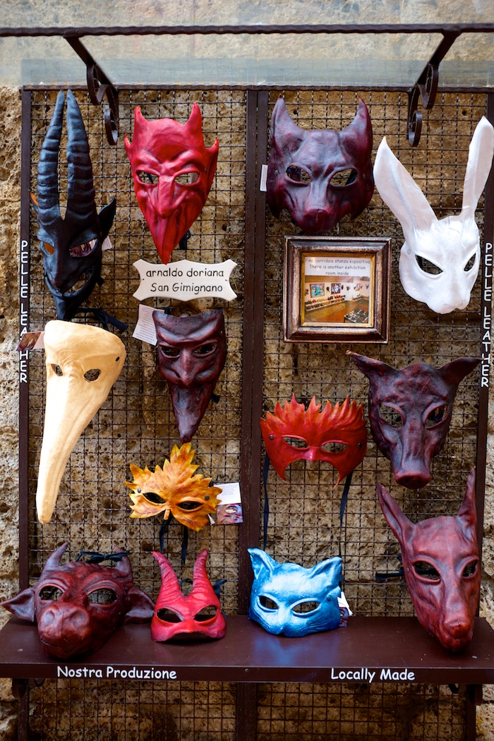 Creepy Italian masquerade masks. Also, Comic Sans. Boo.
