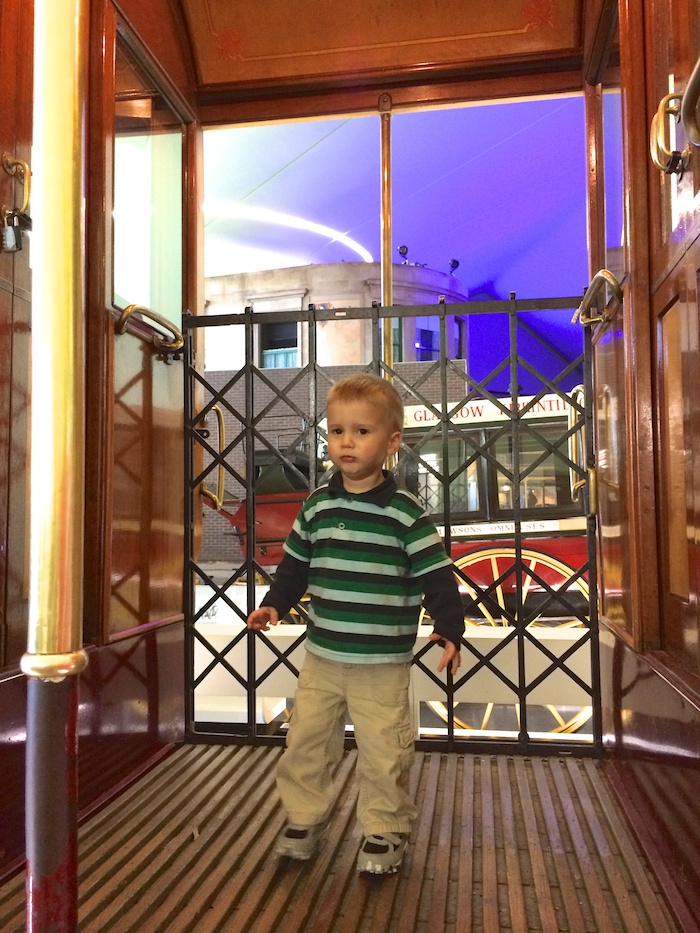 Liam on an old timey double decker bus